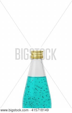 Closed Bottle With A Refreshing Cocktail Isolated On A White Background. An Exotic Refreshing Drink.