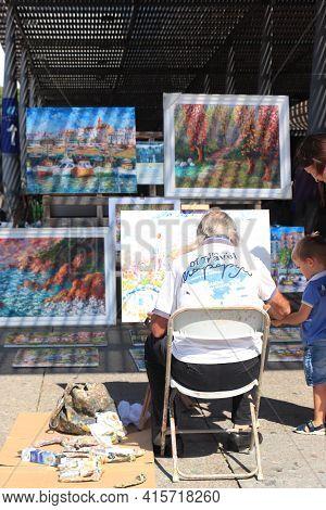 Barcelona, Spain - September 29th 2019: Painting Artist On The Street Near Port Of Barcelona