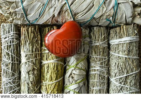 A Top View Image Of White Sage Bundles With A Red Jasper Heart Crystal.