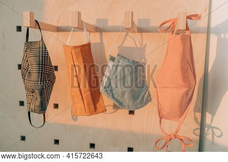 Face masks made of different fabric, styles at fashion store. Retail business for corona virus prevention selling non medical mask covering.