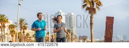 Sport athletes running outdoor banner. Couple of fitness runners Asian woman and caucasian man jogging outside. Active healthy lifestyle. friends training together on fitness jog. Multiracial group.