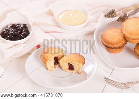 Pasticciotto Cake With Cream Filling On White Dish.