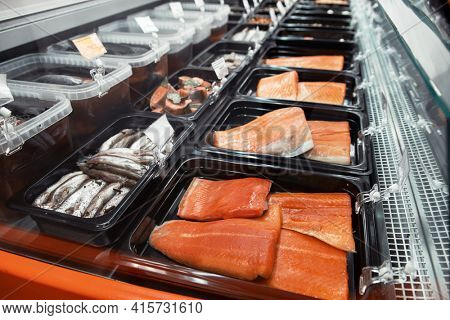 Fish and seafood stall in a market. Healthy eating and fish market concept