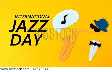 Silhouette Of A Musician With A Saxophone From Which Melodie Flew Out, On A Yellow Background, Cutte