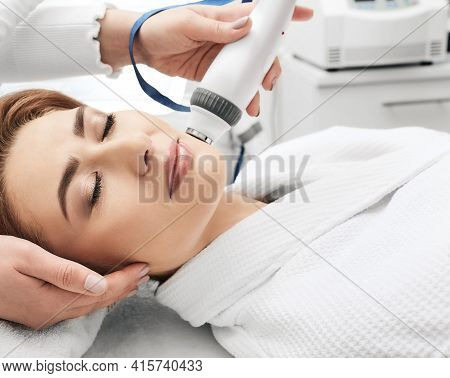 Adult Woman During Rf-lifting Face Skin Tightening With Her Beautician At A Beauty Salon, Close-up