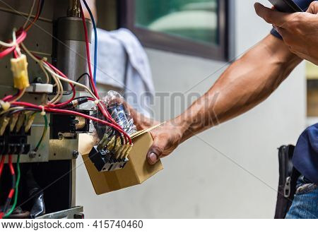 Close Up Of Air Conditioning Repair, Repairman Installing Magnetic Contactor And Fixing Air Conditio