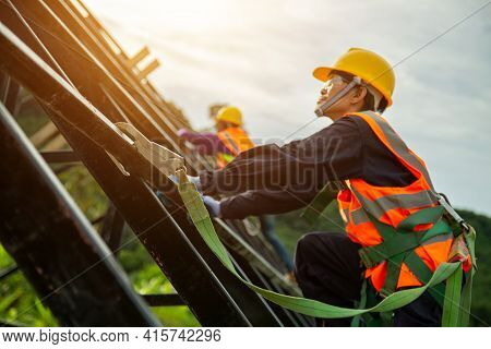 Safety Body Construction, Engineer Technician Working At Height Equipment. Fall Arrestor Device For