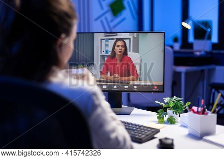 Manager Talking With Teamates During Online Teleconference