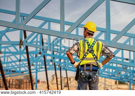 Engineer Technician Watching Warehouse Steel Roof Structure , Engineer Technician Looking Up And Ana
