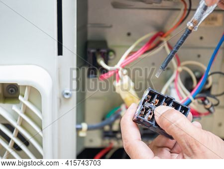 Close Up Of Air Conditioning Repair, Repairman Test, Checking And Repair Of Magnetic Contactor And F