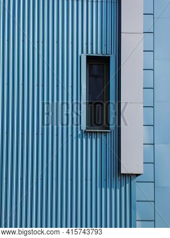 Details Of Aluminum Facade And Aluminum Panels With Window On Industrial Building