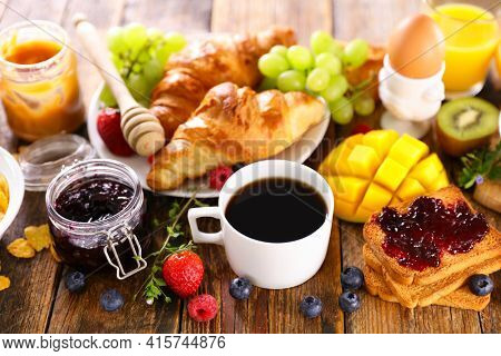continental breakfast with coffee cup, fruit and croissant