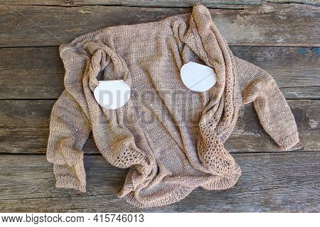 Strip From Sweat Attached To The Armpits To Knitted Jacket.