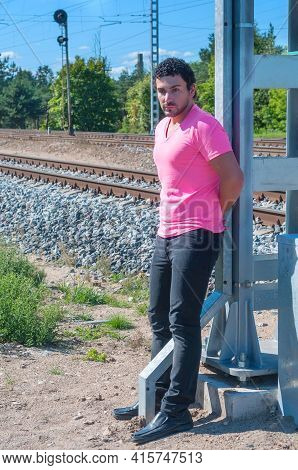 Handsome Young Guy In Pink T-shirt Watching On You