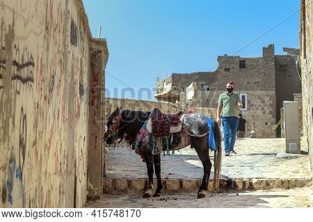 Mardin, Turkey - October 10, 2020: This Is A Horse-riding Donkey Standing At The Gate Of One Of The