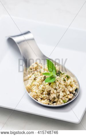 still life of bulgur salad with mint