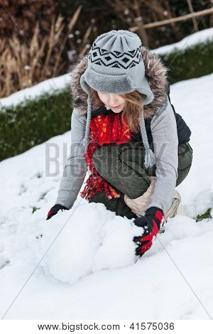 Teenager Girl Making Snowman