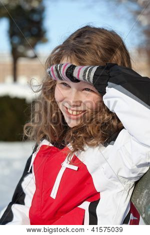 Smiling Girl Sitting On A Bench