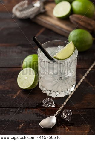 Gimlet Kamikaze Cocktail In Crystal Glass With Lime Slice And Ice On Wooden Background With Fresh Li
