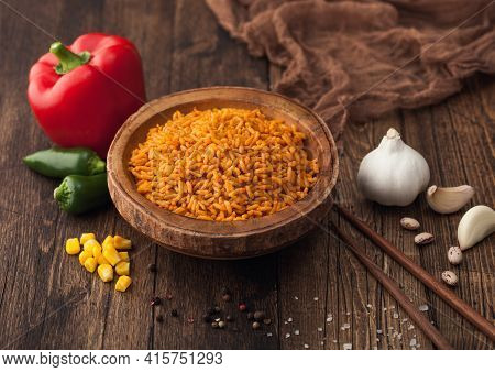 Wooden Bowl With Boiled Red Long Grain Basmati Rice With Vegetables On Wooden Background With Sticks