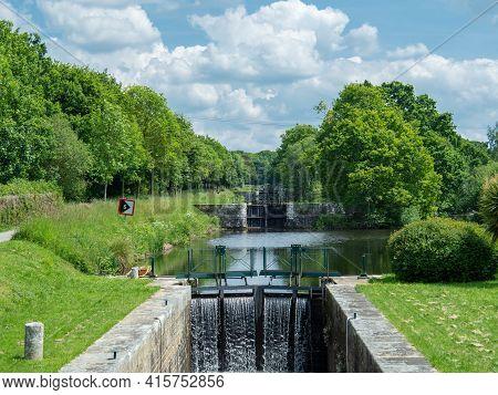 Flight Of Locks At The Historic Canal De Nantes A Brest, France.