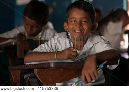 Bluff, Nicaragua. 03-17-2019. Portrait Of A Smiling Boy Writing At School In The Town Of Bluff In Ni