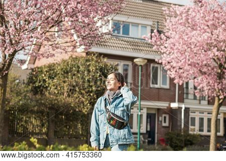 Young Cheerful Mixed Races Woman Outdoor In Front Of Her House Taking Some Fresh Air Under Sunbeams