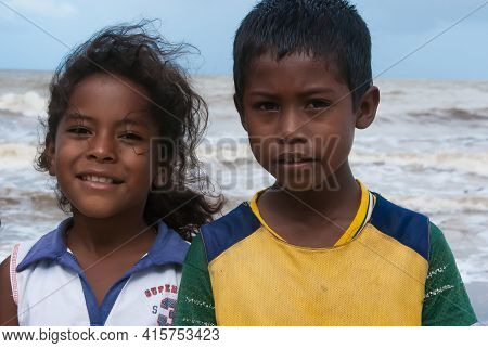 Sandy Bay, Nicaragua. 03-16-2019. Portrait Of A Boy And A Girl With The View Of The Ocean At Their B
