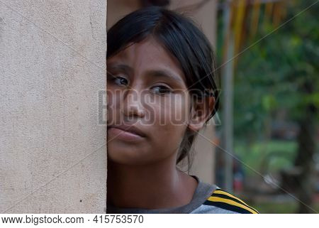 Sandy Bay, Nicaragua. 03-15-2019. Close Up Of An Female Adolescent Having Her Face Supported On A Wa