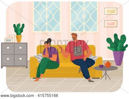 Young Couple Sitting On Couch Quarreling At Home. Man And Woman Couple In Bad Relationship