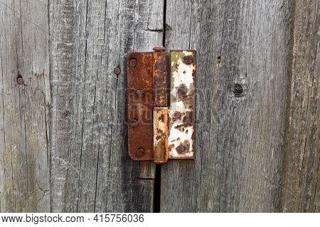 Old Rusty Metal Door Hinge. Door Hinge On A Wooden Door.