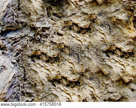Black And Rough Rough Texture Of The Stone With Depressions And Pits On The Surface