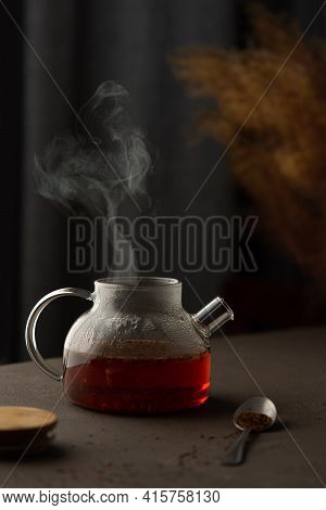The Process Of Brewing Rooibos Tea With Herbs, Glass Teapot With Caffeine Free Tea Drenched In Boili