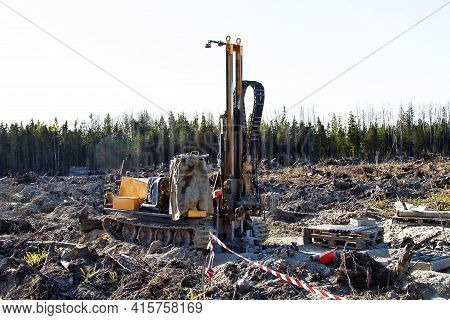 Mini-drilling Rig On Crawler Track On Site Of Sawn Forest Where Large-scale Enterprise Will Be Built