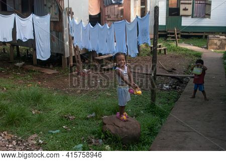Sandy Bay, Nicaragua. 03-15-2019. A Girl Is At Her Home Where The Cloths Were Hang After Being Washe