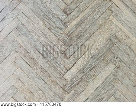 Close Up Texture Of Old Parquet. Wooden Flooring In Old Building. Plank Floor Surface. Classic Light