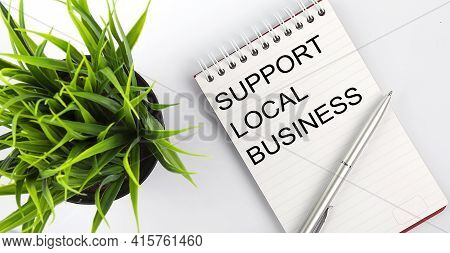 Keyword Support Local Business - Business Concept Text On White Notebook And Pen, Green Flowers