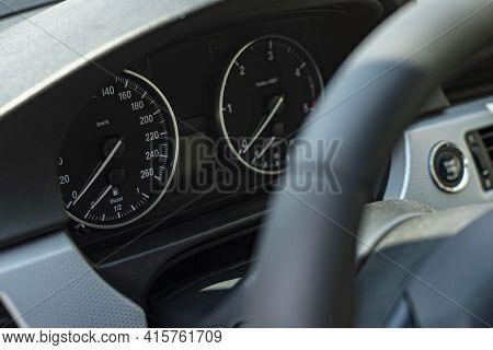 Odometer And Hands Of Luxury Car