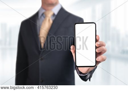 Businessman Showing Phone. Businessman Shows Cell Phone With Blank Screen. Man Hold Smart Mobile Cel