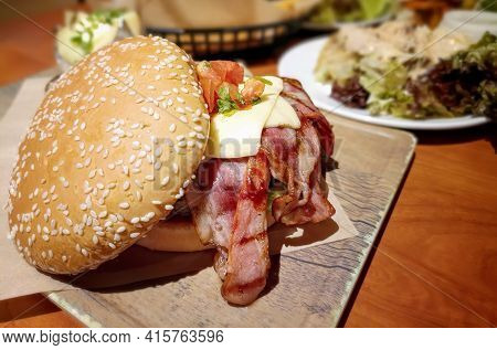 Bacon Cheese Burger Served In A Restaurant