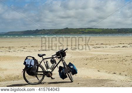 A Heavily Packed Touring Bicycle On A Beach In Brittany, France.