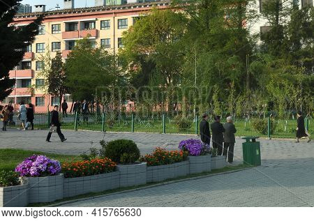 Pyongyang, North Korea - April 29, 2019: Local People Shown On The Street In Pyongyang Residential D