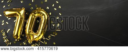Gold Foil Balloon Number Seventy. Birthday Or Anniversary Card With The Inscription 70. Black Concre
