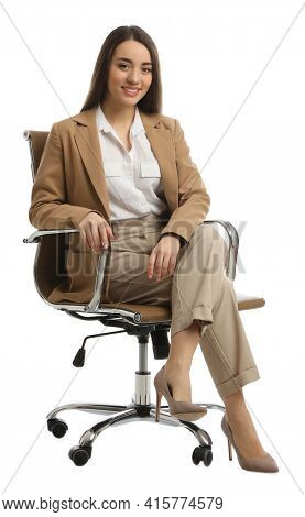 Young Businesswoman Sitting In Comfortable Office Chair On White Background