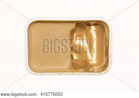 Peanut Butter In A Container On A White Background Top View.peanut Butter Made From Whole Nuts.