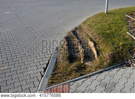 Drive Over The Edges Of A Lawn Track From Heavy Trucks, A Poorly Designed Turning Radius Means Damag