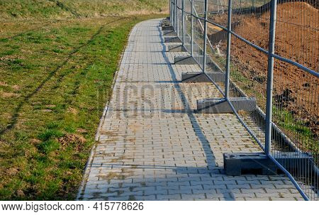 Construction Sites With Portable Fence Parts That Are Installed In Plastic Weight Racks Hold The Sta