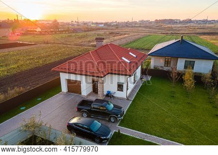 Aerial View Of A Private Suburban House With Parked Cars In Back Yard.