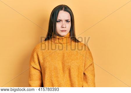 Young hispanic girl wearing casual clothes skeptic and nervous, frowning upset because of problem. negative person.