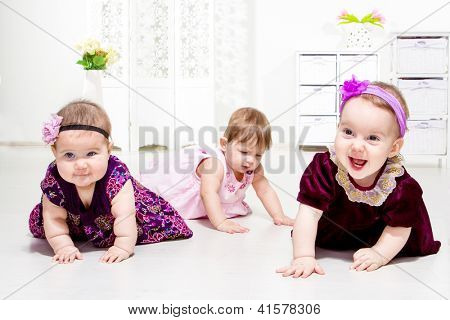 Happy laughing toddlers in the living room